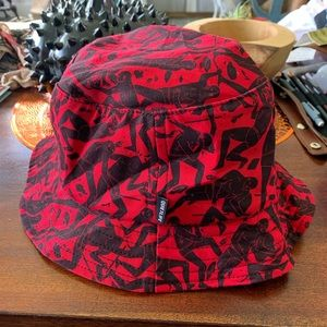 The Quiet Life Bucket Hat by Andy Mueller